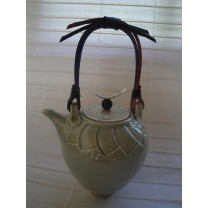Celadon Porcelain Teapot  With Cane Handle And Silver Knob by Bridget Drakeford